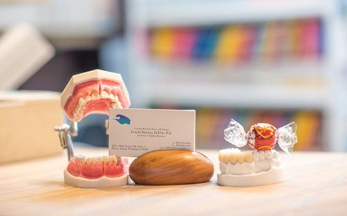 Dr. Shiotsu Business Card on Desk next to Candy - Mercer Island Dentist