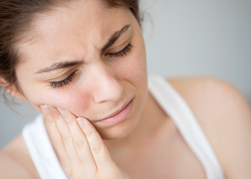 Woman with jaw pain in need of TMJ disorder appointment with Dr. Shiotsu in Mercer Island