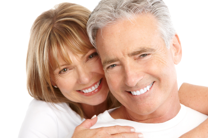 Older couple smiling after getting Restorative Dentistry by their Mercer Island Dentist at Goichi Shiotsu, DDS.