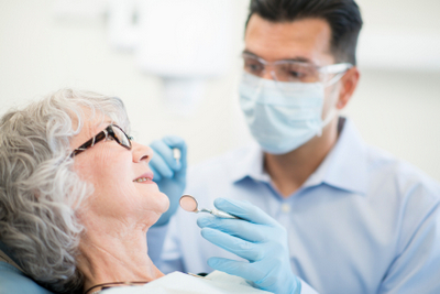 An elderly patient talks with her Mercer Island dentist about the possibility of full mouth reconstruction.
